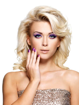 Beautiful blond woman with beauty purple manicure and makeup of eyes  Fashion model with curly hairstyle  Stock Photo - 16317297