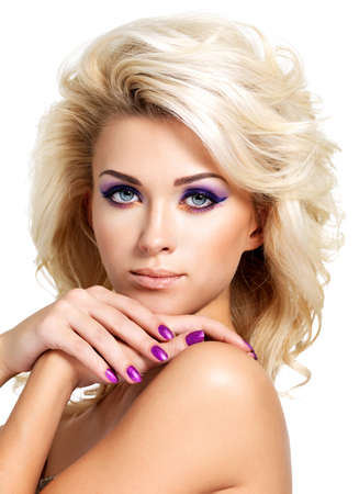 Beautiful blond woman with beauty purple manicure and makeup of eyes  Fashion model with curly hairstyle  Stock Photo - 16317290