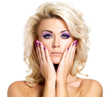 Beautiful blond woman with beauty purple manicure and makeup of eyes  Fashion model with curly hairstyle  Stock Photo - 16317286