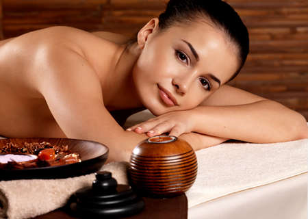 Calm woman after massage relaxing in spa salon. Beauty treatment concept. photo