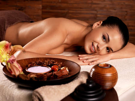 Recreation therapy for woman after massage in spa salon. Beauty treatment concept. photo