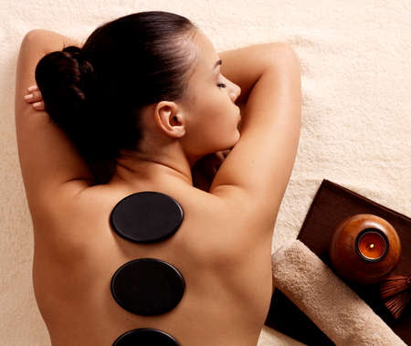 hot girl lying: Young woman having stone massage in spa salon. Healthy lifestyle.