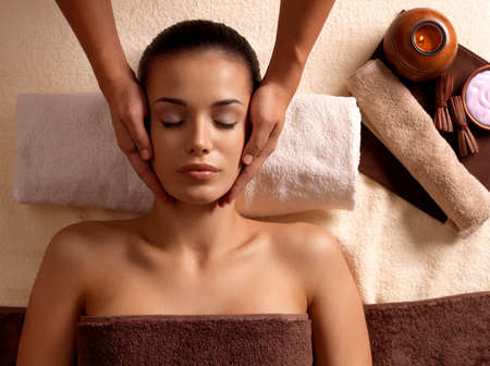 pamper: Masseur doing massage on woman body in the spa salon. Beauty treatment concept.