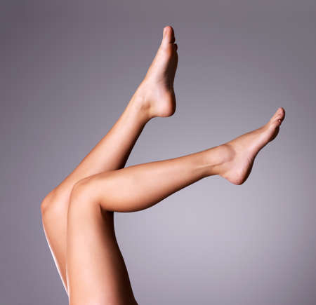 bare body women: Beautiful slender female legs.