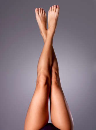 Beautiful long slender female legs after dilapidation.   photo