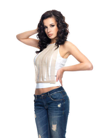 long pants: Full portrait of fashion model with long hair dressed in blue jeans