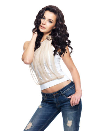Full portrait of fashion model with long hair dressed in blue jeans Stock Photo - 16469056
