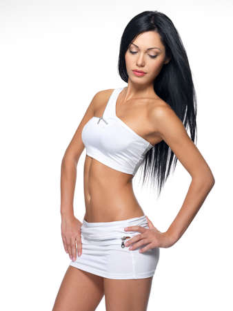 Beautiful woman with sporty slim body - studio shot Stock Photo - 16578444