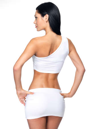 Back view of the young woman with beautiful slim health body posing at studio Stock Photo - 16578439