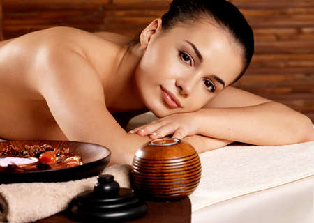 calm woman: Calm woman after massage relaxing in spa salon. Beauty treatment concept.