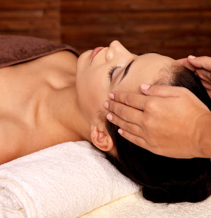 eye massage: Masseur doing massage on woman body in the spa salon. Beauty treatment concept.