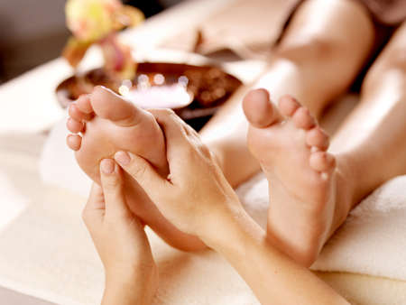 beauty spa: Massage of human foot in spa salon - Soft focus image