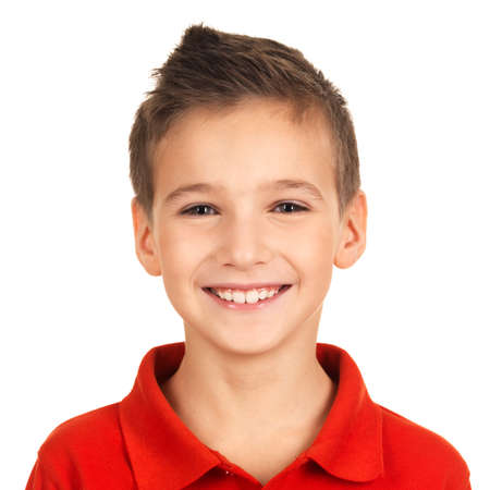 teen boy face: Photo of adorable young happy boy looking at camera.  Stock Photo