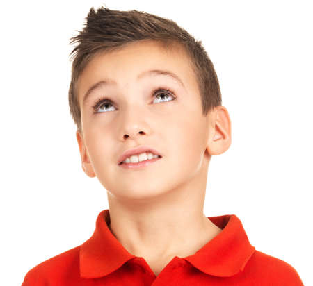 teen boy face: Portrait of adorable young boy looking up. Isolated on white