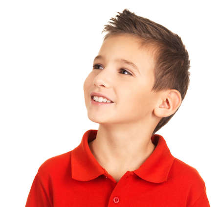 Photo of pretty young happy boy looking away over white background