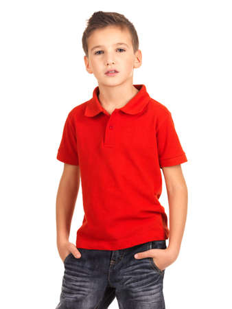 red jeans: Young beautiful boy posing at studio as a fashion model. Photo of preschooler 8 years old over white background