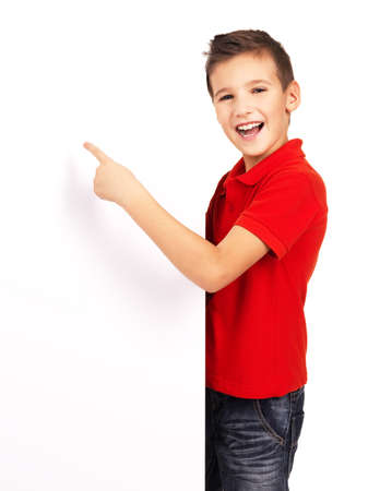 9 year old: Portrait of  cheerful boy pointing on white banner - isolated on white background