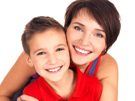 Portrait of a happy young mother with son 8 year old over white background photo