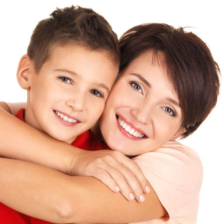 mom and son: Portrait of a happy young mother with son 8 year old over white background Stock Photo