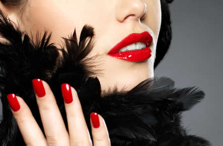 fingernail: Macro photo of  woman with fashion red nails and sensual lips