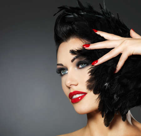 human fingernail: Beautiful fashion woman with red nails, creative hairstyle and makeup - Model posing in studio
