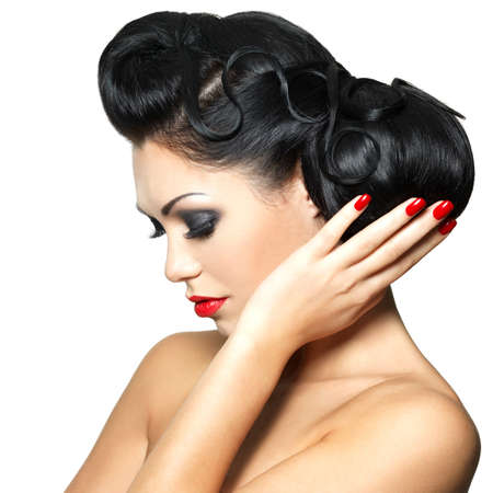 Beautiful fashion woman with red lips, nails and creative hairstyle - isolated on white background Stock Photo - 16732169