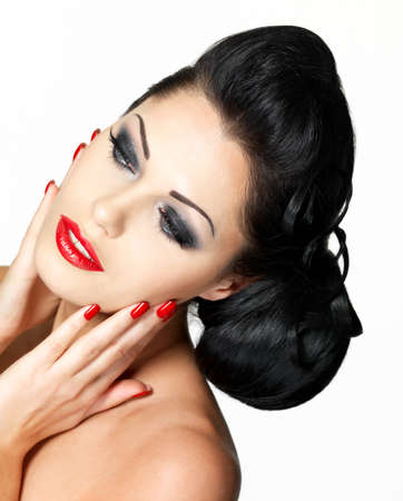 Beautiful fashion woman with red lips, nails and creative hairstyle - isolated on white background Stock Photo - 16732171
