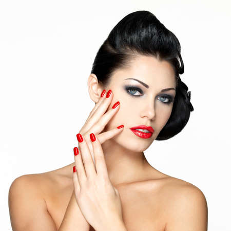 nails manicure: Beautiful young woman with red nails and fashion makeup - isolated on white background Stock Photo