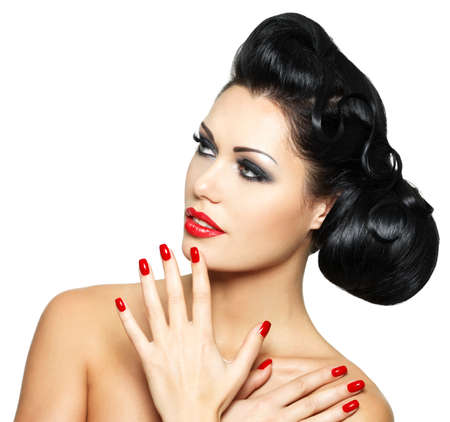 Beautiful fashion woman with red lips, nails and creative hairstyle - isolated on white background Stock Photo - 16690781