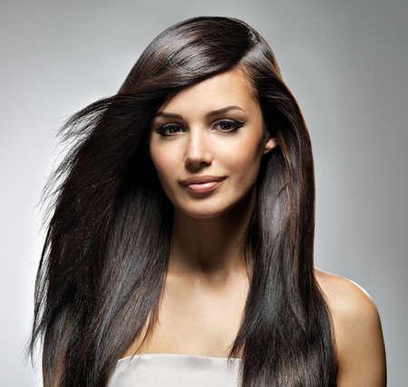 Beautiful woman with long straight hair. Fashion model posing at studio. Stock Photo - 16732176