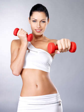 Photo of a healthy training young woman with dumbbells.  Healthy lifestyle concept. Stock Photo - 16642966