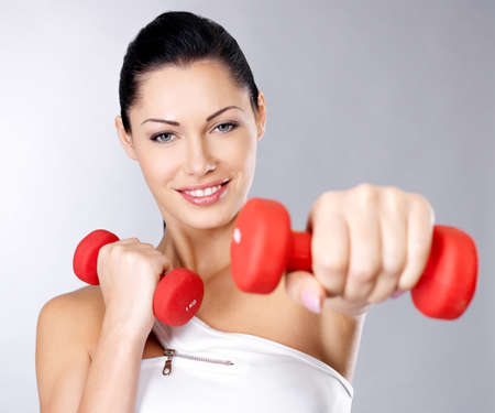 Photo of a healthy training young woman with dumbbells.  Healthy lifestyle concept. Stock Photo - 16690765