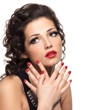 Beautiful  fashion woman with red manicure and lips - isolated on white background Stock Photo - 16690762