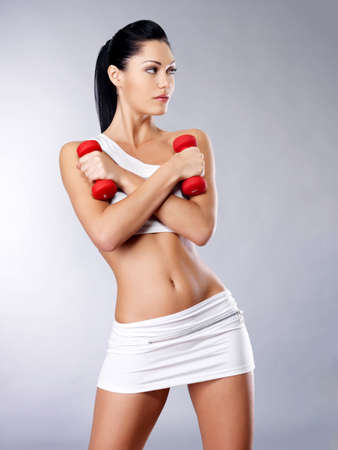 Photo of a healthy training young woman with dumbbells.  Healthy lifestyle concept. Stock Photo - 16642955