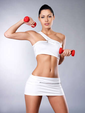 Photo of a healthy training young woman with dumbbells.  Healthy lifestyle concept. Stock Photo - 16642957