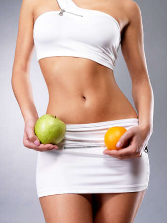 Healthy lifestyle of woman with slim body after diet. Sporty female with perfect figure Stock Photo - 16642989