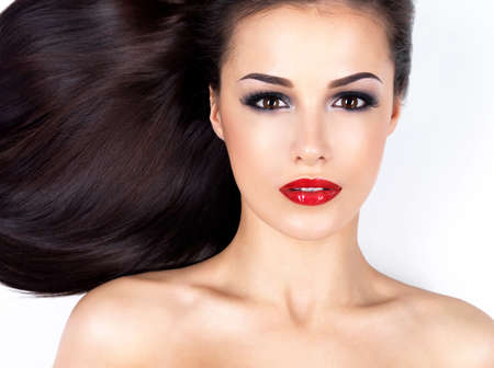 red lips: Photo of a beautiful woman with long straight brown hair looking at camera