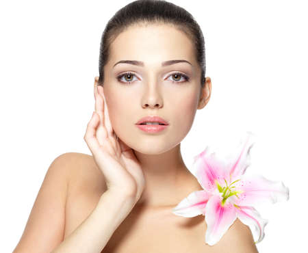 Beauty face of young woman with flower. Beauty treatment concept. Portrait over white background Stock Photo - 16858812