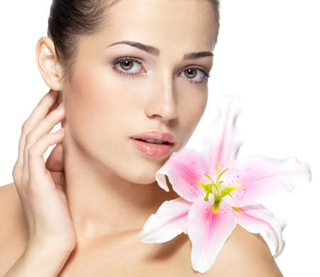 Beauty face of young woman with flower. Beauty treatment concept. Portrait over white background Stock Photo - 16858800