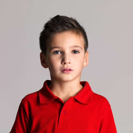 Portrait of adorable young beautiful boy posing at studio photo