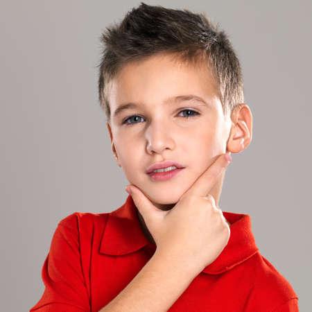 grey  hair: Adorable young beautiful boy  posing at studio