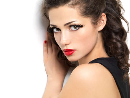 sensual lips: Beautiul fashion girl with red sensual lips - isolated on white background Stock Photo