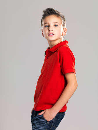 8 years old: Pretty boy posing at studio as a fashion model. Photo of preschooler 8 years old over white background Stock Photo