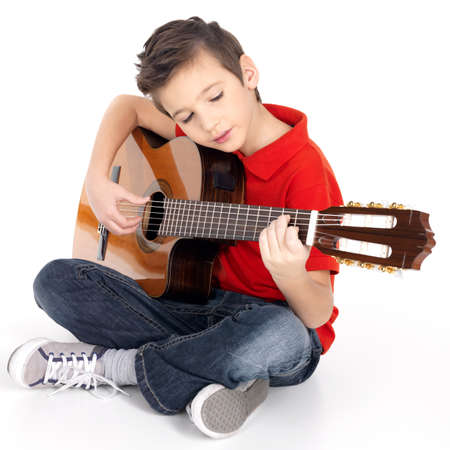 a guitarist boy playing guitar: Caucasian boy is playing the acoustic guitar - isolated on white background Stock Photo