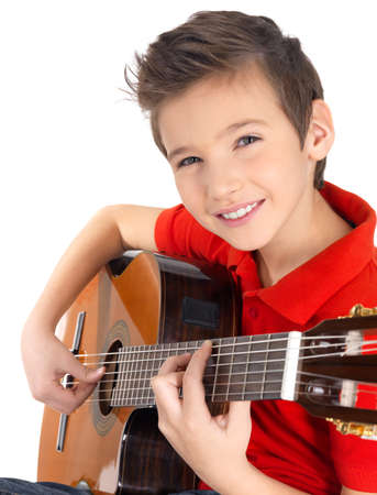 handsome boys: Smiling caucasian boy is playing on acoustic guitar - isolated on white background Stock Photo