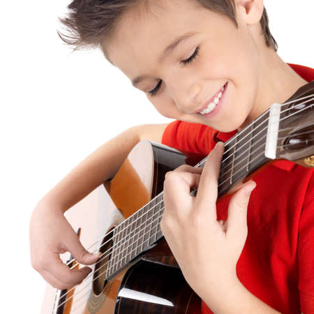 guitar: Smiling caucasian boy is playing on acoustic guitar - isolated on white background Stock Photo