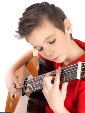 a guitarist boy playing guitar: White boy is playing on acoustic guitar - isolated on white background