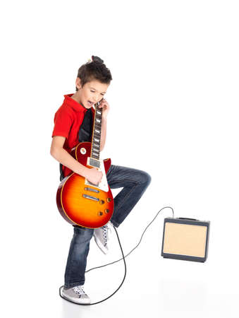 young musician: A young white boy sings and plays on the electric guitar with bright emotions, isolatade on white background