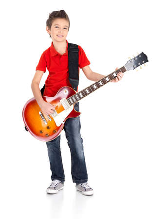 Portrait of young boy with a electric guitar - isolated on white background photo