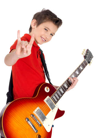 White young boy with a electric guitar shows the heavy metal geasture - isolated on white background photo